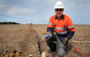 Associate Professor Roman Pevzner, a geophysicist from Curtin University WA, installs geophones into the ground at Nirranda